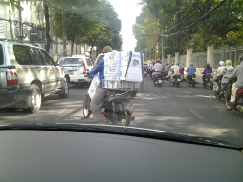 Bottled Water on moped